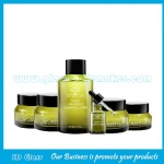 High Quality Olive Green Painting Oblique Shoulder Glass Lotion Bottles and Glass Cream Jars With Printing