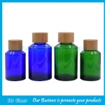 100ml and 120ml Blue and Green Sloping Shoulder Glass Lotion Bottles With Bamboo Caps