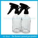 16oz Clear Boston Round Glass Bottle With Black Trigger Sprayer